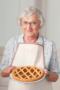 Senior lady with homemade cake